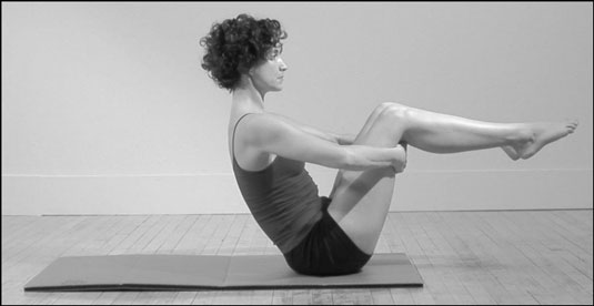 The Balance Point position in Pilates.