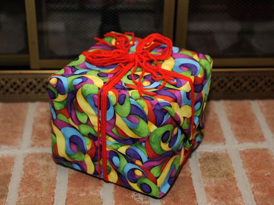 Leftover fabric and extra yarn create green gift wrap!