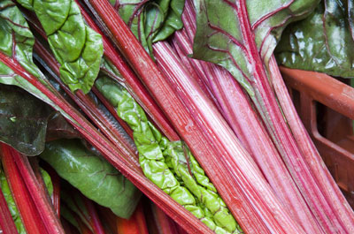 Fresh Swiss chard ready for action in a food photo. [Credit: Focal length: 55mm, Shutter speed: 1/2