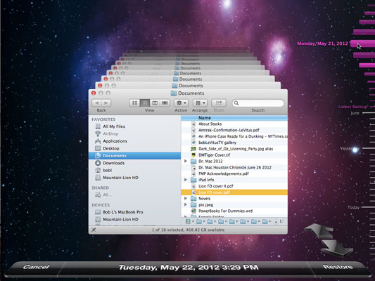 The Time Machine application is ready to restore a file in the Finder.