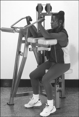 The arm-curl machine is a gym alternative to the dumbbell biceps curl. [Credit: Photograph by Sunst