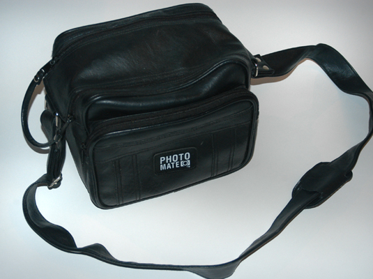 Look for a serviceable padded camera case like this one at your local discount store.
