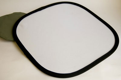 A small, 12-inch white reflector.