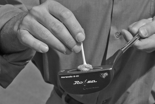 Stick a tee to the face of your putter to help align your club with your target.