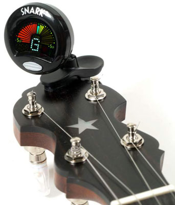 Using an electronic clip-on tuner makes banjo tuning easier. [Credit: Photograph courtesy of Elderl