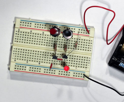 A two-transistor NAND gate on a breadboard.