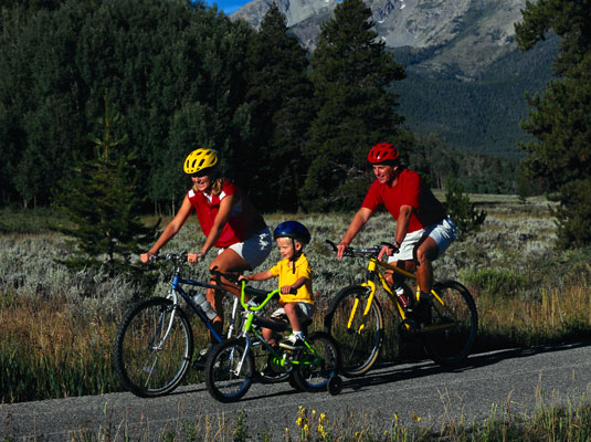 Biking together is one way to be a green family. [Credit: Corbis Digital Stock]